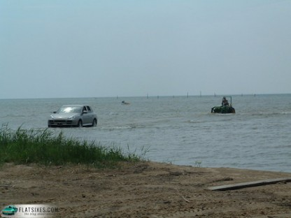 Porsche Cayenne Pulls Swamped Tractor From Lake Huron