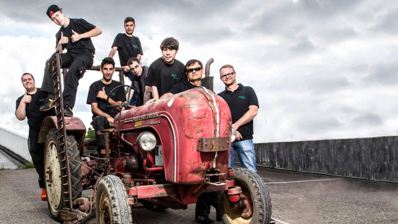Students on Porsche tractor as part of the Porsche Junior project