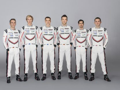 Porsche's complete LMP1 919 Factory driver line-up standing together in racing suits for a press photo