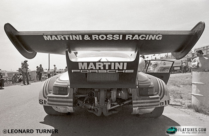 rear view of a Porsche Turbo Carrera RSR showing it's massive whale tale during a race at Watkins Glen 1974