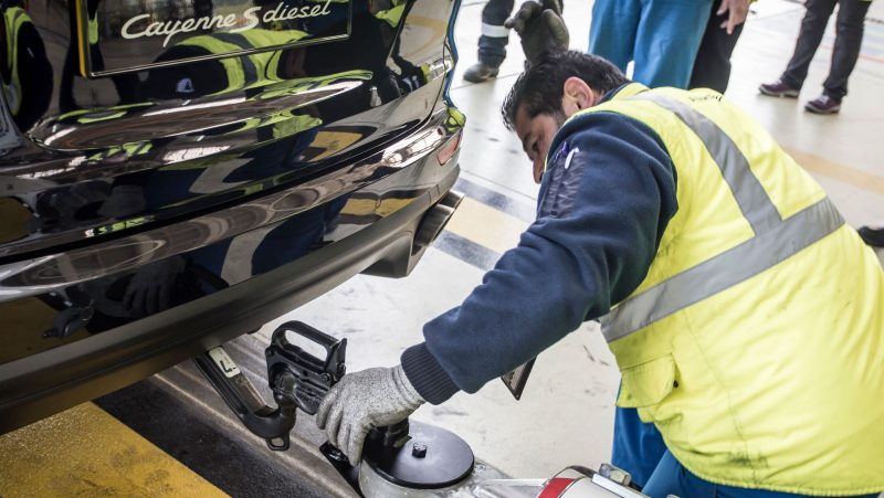 technician attaching a special towbar to the Porsche Cayenne that towed an airbus a380