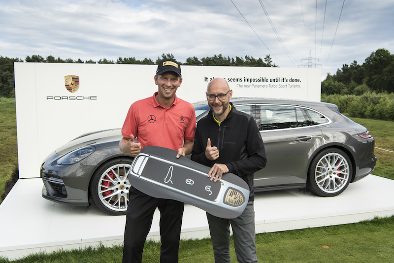Marcel Siem Accepts Key for Panamera Turbo Sport Turismo he won for a hole-in-one on the 17th hole