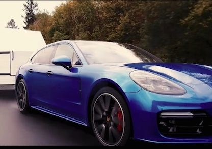 Porsche Panamera towing a trailer on the Nurburgring