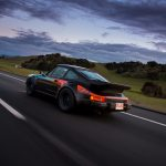 Dark skies cloud over 911 Turbo viewed from the rear